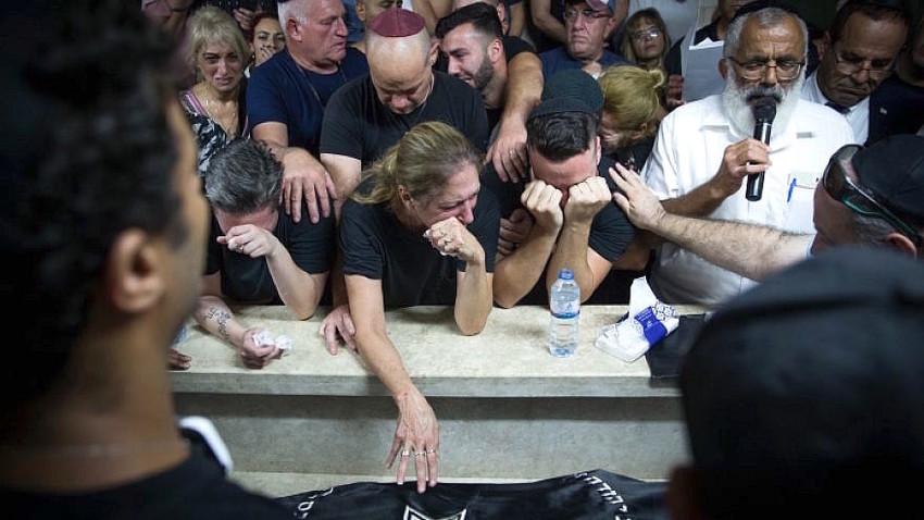 Family and friends at the levaya of Kim Levengrond Yehezkel on Sunday. Yehezkel was slain along with Ziv Hajbi.
