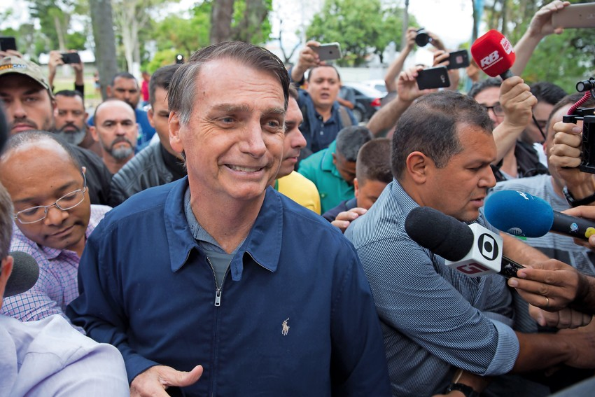 Brazil's right-wing presidential candidate for the Social Liberal Party (PSL) Jair Bolsonaro leaves Villa Militar, after casting his vote during general elections, in Rio de Janeiro on Oct. 7.