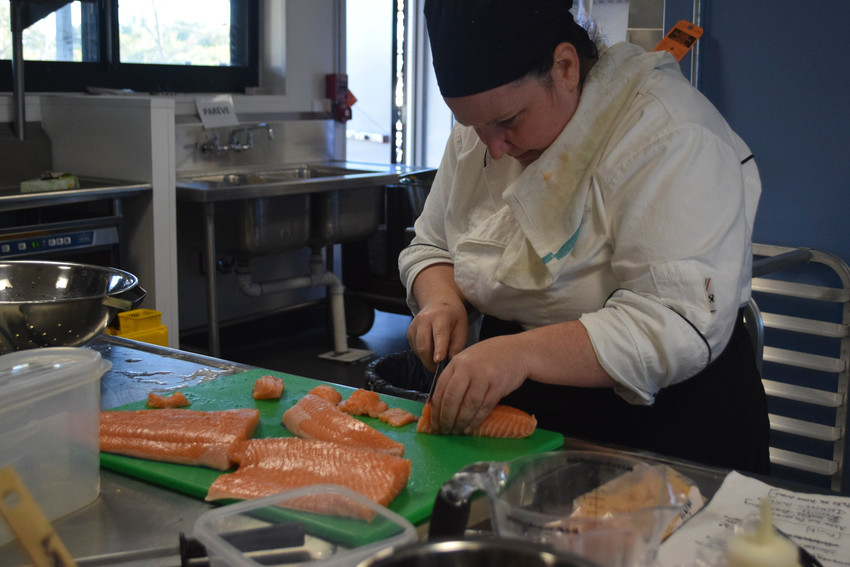 Chef Nina Vincenzina carved up a salmon in Kulanu Adademy's new commercial-grade kitchen.