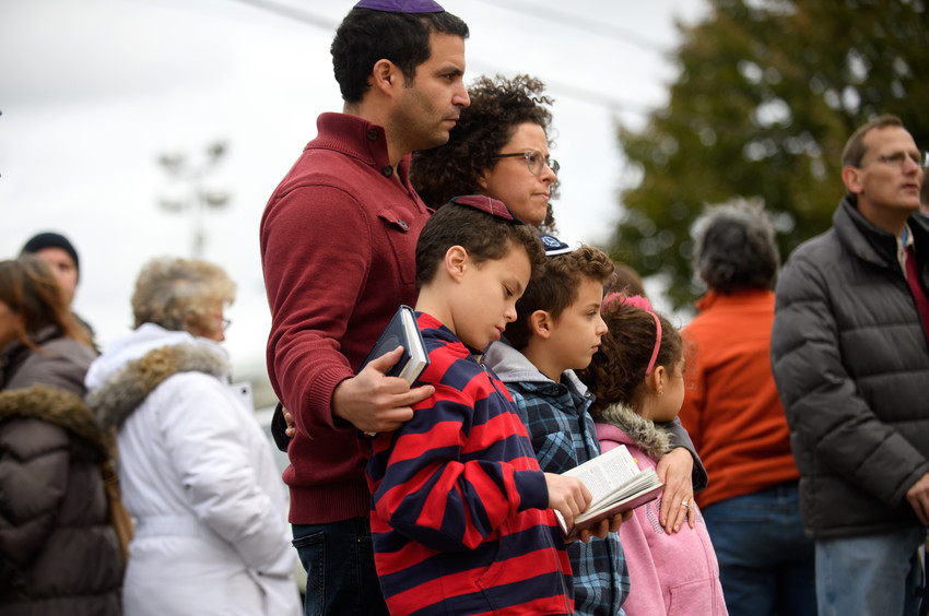 A family pauses in front of at a memorial for victims of the mass shooting that killed 11 people and wounded 6 at the Tree Of Life Synagogue on Oct. 29 in Pittsburgh.