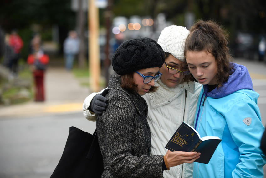 From left: Tammy Hepps, Kate Rothstein and her daughter, Simone Rothstein, 16, pray a block away from the site of a mass shooting at the Tree of Life Synagogue in the Squirrel Hill neighborhood of Pittsburgh, on Oct. 27.