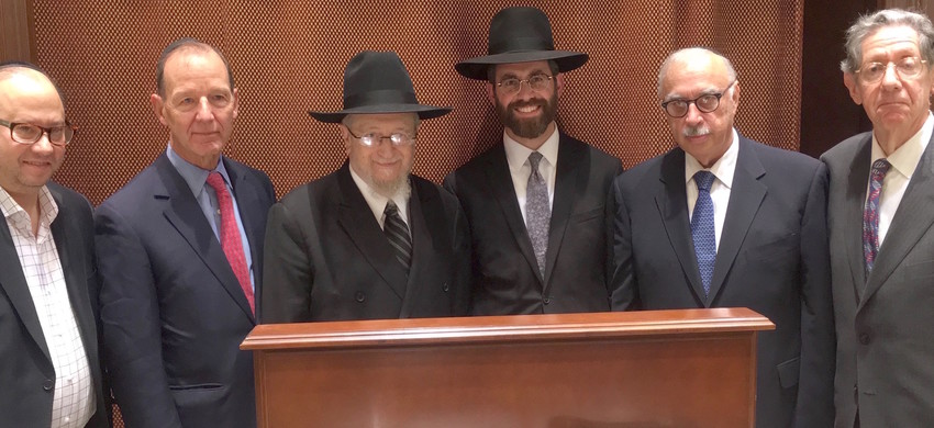 At the Five Towns' Kristallnacht remembrance, at Kehillas Bais Yehudah in Cedarhurst, from left: David Klein, Theodore Roosevelt IV, rabbis Yaakov Feitman and Ephraim Polakoff, cantor Robert Vegh, and event co-chair Alan Jay Gerber.