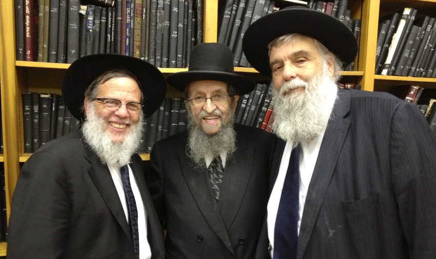 Rabbi Chanina Herzberg is pictured with, from left, Rabbis Mordechai and Shmuel Kamenetzky.