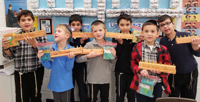 CAHAL students at Yeshiva Darchei Torah with their menorahs.