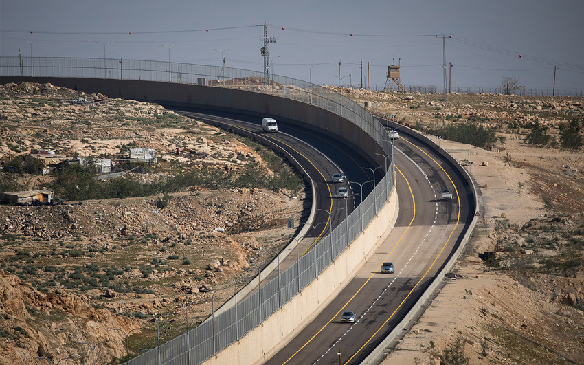 Route 4370, with a wall dividing Israeli and Palestinian traffic, on Jan. 10.