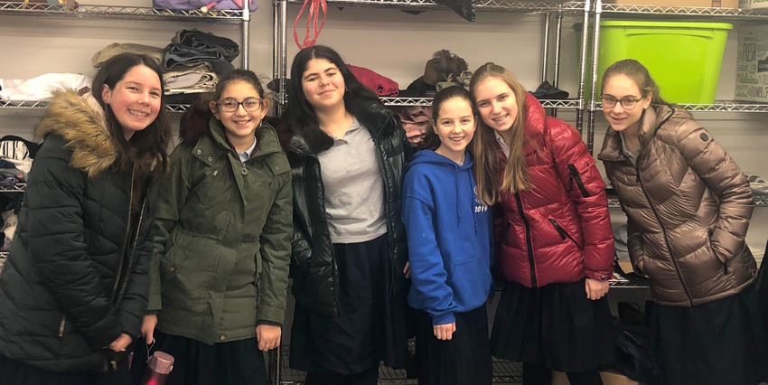 Helping out: Shulamith students Gitty Sharf, Ora Zeitlin, Noy Edery, Rebecca Schoenfeld, Tamar Pilevsky, and Anat Ebbin.