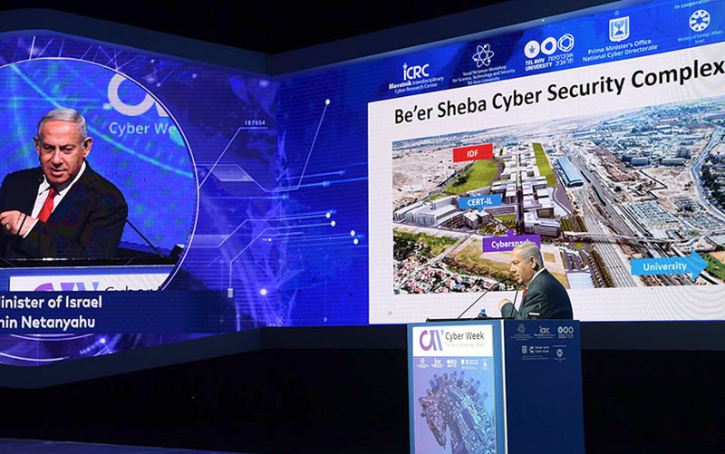 Israeli Prime Minister Benjamin Netanyahu addresses the Eighth Annual International Cybersecurity Conference at Tel Aviv University on June 20, 2018.