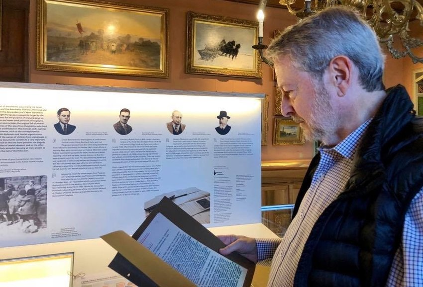 Jeffrey Cymbler examining documents tied to the Bernese Group in Switzerland.