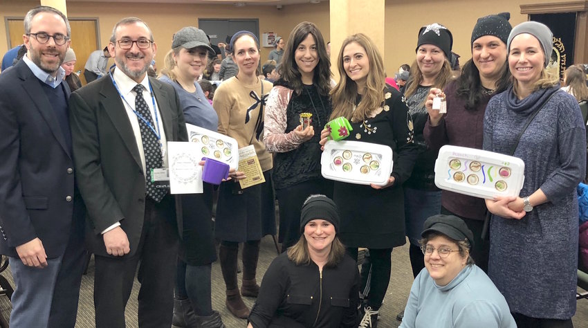 Standing from left: Rabbi Josh Goller, assistant rabbi at YIWH; Rabbi Hillel Fox, Northshore University Hospital chaplain; and Orit Lax, Adina Frankel, Jen Toplan, Ayelet Mottahedeh, Judy Feldman, Shulamit Hurwitz and Anat Schick. Sitting: Kari Levine and Ann Koffsky.