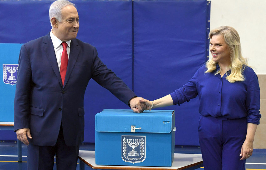 Israeli Prime Minister Benjamin Netanyahu and his wife Sara cast their vote at a polling station in Jerusalem during the Knesset elections, on April 9.