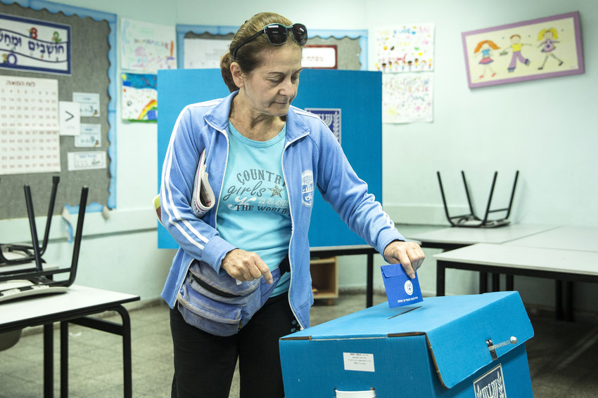 A woman cast her ballot at a polling station in Rosh Hayein on April 9, 2019 in Rosh Ha'ayin.