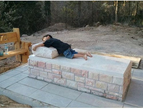 4-year-old Lahav Cohen visiting the final resting place of his father Michael for the first time.