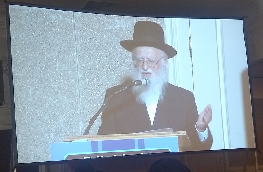 Rabbi Hillel Handler, an anti-vaccination leader, speaks via projection screen to an anti-vaccination rally in an Orthodox Brooklyn venue on June 4.