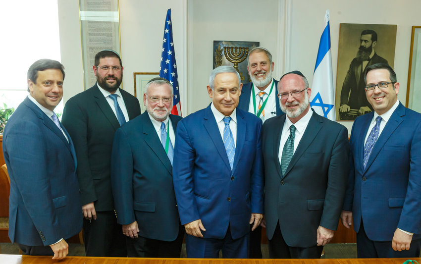 Israeli Prime Minister Benjamin Netanyahu is flanked by representatives of the Orthodox Union, including (left of Netanyahu) Executive Vice President Allen Fagin, of Woodmere, and (right of Netanyahu) OU President Moishe Bane of Lawrence.