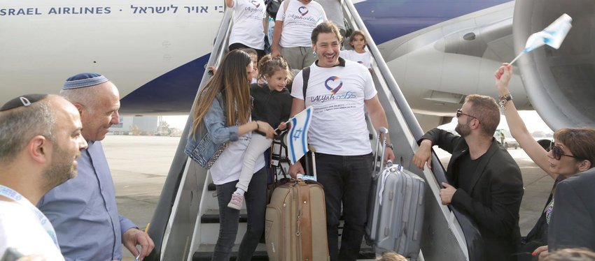 New immigrants from France, Russia, Argentina, Brazil and Venezuela land in Israel last Wednesday.