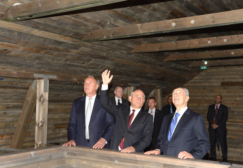 Israeli President Shimon Peres, right, and Latvia President Andris Berzinns, left, at the opening of the Zanis Lipke Memorial Museum in Riga, Latvia, in 2013.