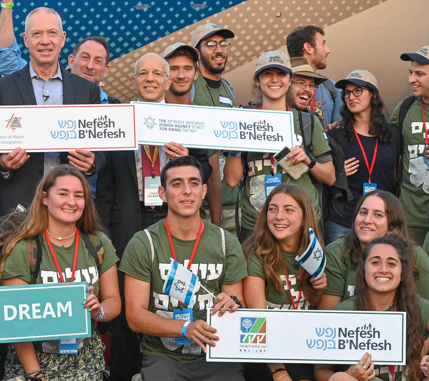 The 242 new olim on Nefesh B'Nefesh's 60th El Al charter flight included NBN's 60,000th oleh, Co-Founder and Executive Director Rabbi Yehoshua Fass said. Pictured are some of 41 future Lone Soldiers who were among olim from 22 U.S. states and two Canadian provinces on last week's flight.