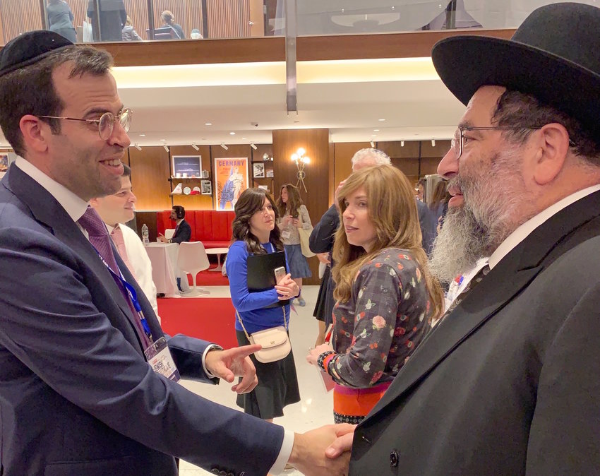 Achiever President Boruch Ber Bender greets his father, Harav Yaakov Bender, rosh hayeshivah of Yeshiva Darchei Torah in Far Rockaway, at Achiezer's Jewish Healthcare Conference & Expo in the TWA Hotel at JFK, on Sunday, Sept. 15.