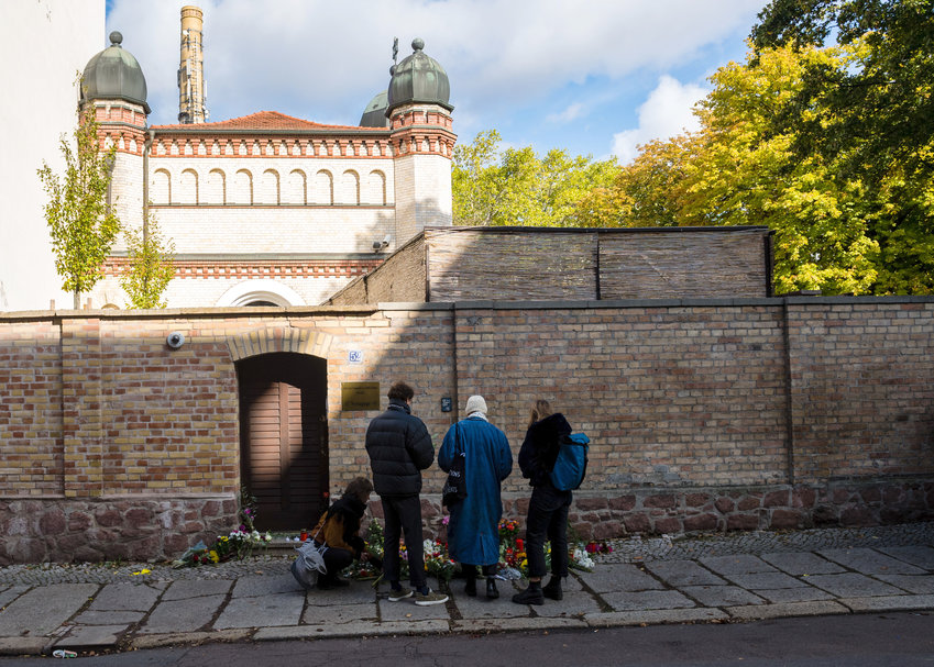 People mourn at the entrance to the Jewish synagogue on Oct. 10 in Halle, Germany.