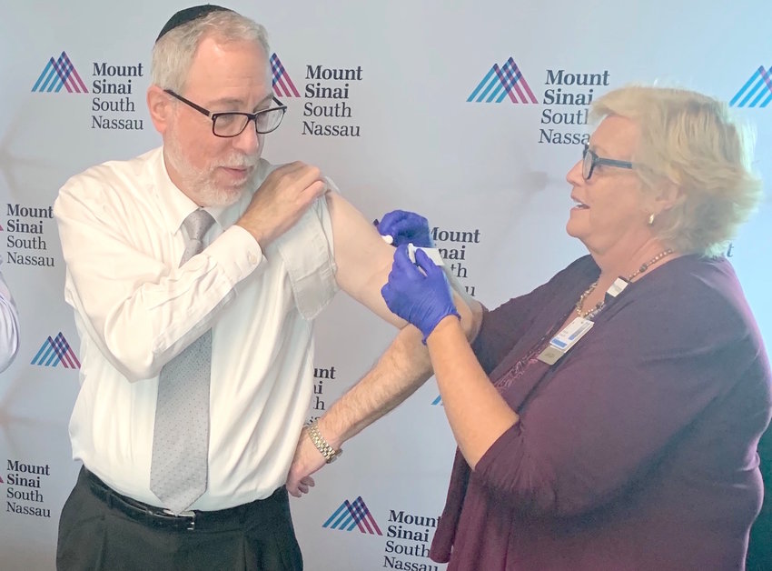 Rabbi Dr. Aaron Glatt got his flu shot during a vaccination event hosted on Tuesday by Richner Communications, parent company of The Jewish Star, at its offices in Garden City.