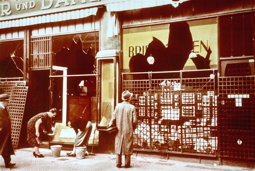 """Assessing some damage after Kristallnacht, """"Night of Broken Glass,"""" in Germany, Nov. 9–10, 1938."""
