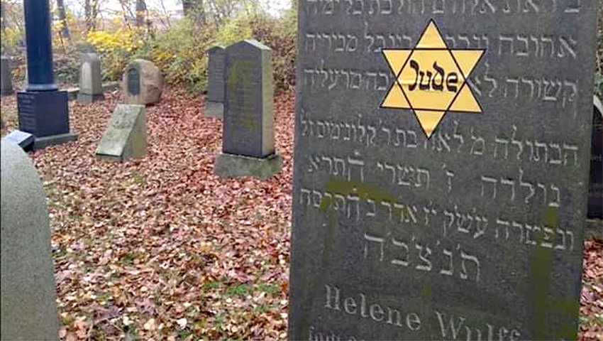 A Yellow star sticker on a Jewish grave in Denmark on Nov. 10.