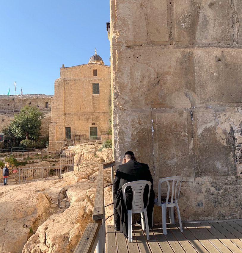 A Jew outside Kever ha Machpelah on Nov. 28 is pictured praying at the site of the seventh step, where Jews prayed during 700 years (1257-1967) when they were not permitted inside.