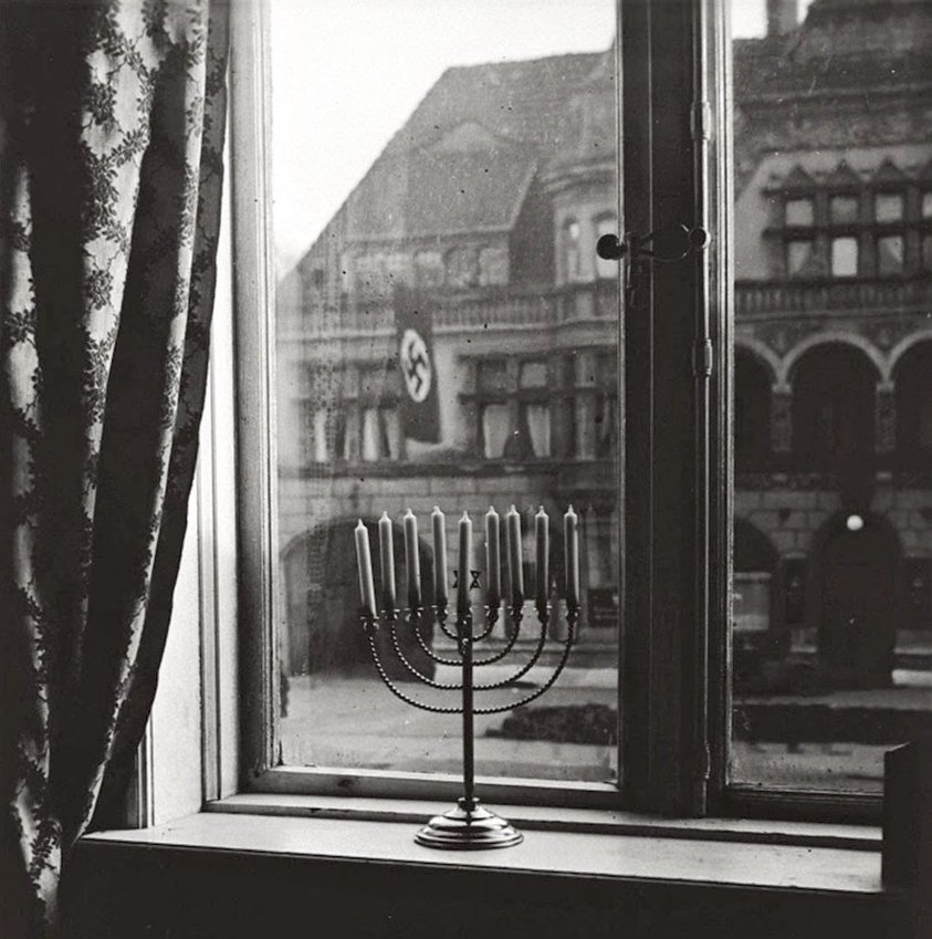 """Chanukah 5692. 'Judea dies,' thus says the banner.  'Judea will live forever,' thus respond the lights."""