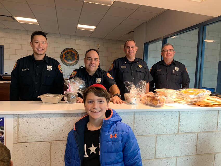 Matthew Schein took baked goods to two fire departments and a police station.