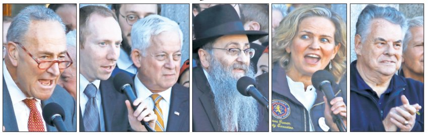 At Sunday's rally outside the Theodore Roosevelt Executive and Legislative Building in Mineola, from left: U.S. Senate Minority Leader Chuck Schumer, Stand With Us Northeast Regional Director Avi Posnick with Assemblymember Charles Lavine, Rabbi Anchelle Perl of Chabad of Mineola, Nassau County Executive Laura Curran, and Rep. Peter King.