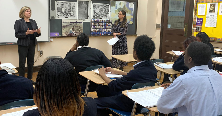 Amy Goldberg, left, and Lindsay Bressman talking to students at Bishop Loughlin Memorial High School in Brooklyn on Jan. 8.