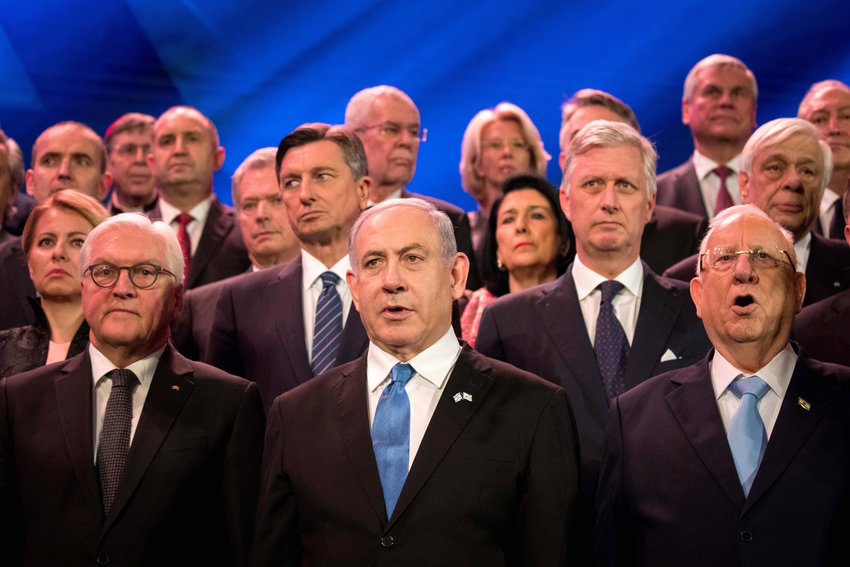 Israeli Prime Minister Benjamin Netanyahu and President Reuven Rivlin pose with world leaders during the Fifth World Holocaust Forum at the Yad Vashem Holocaust memorial museum in Jerusalem on Jan. 23. At left is German President Frank-Walter Steinmeier.