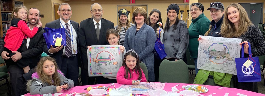 Rabbi Dr. Hillel Fox (second from left), director of chaplaincy care for the North Shore University Hospital in Manhasset, was pleased with the #Giveback effort at the Young Israel of West Hempstead. Third from left: YIWH Rabbi Yehuda Kelemer.