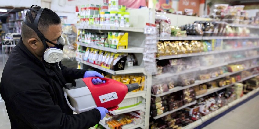 Workers disinfect Bar Kol Supermarket in the northern Israeli city of Tzfat as part of measures to prevent the spread of the coronavirus, on March 16.