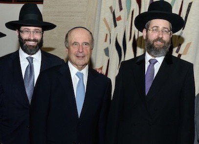 At the White Shul in 2014, Askenazi Chief Rabbi David Lau is flanked by White Shul Rav Rabbi Eytan Feiner and Lawrence Mayor Martin Oliner.