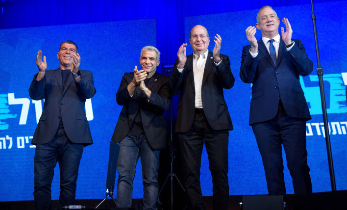 Head of the Blue White party Benny Gantz with party members at the party headquarters in Tel Aviv, on election night, March 3.