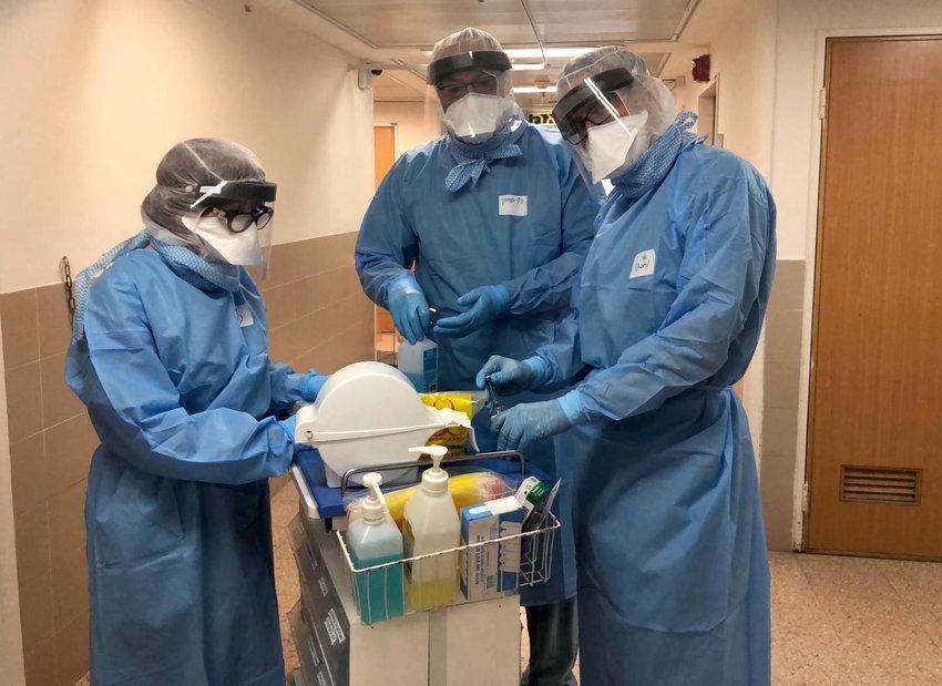 Dr. Elli Rosenberg, right, with colleagues in the coronavirus unit of Soroka Medical Center in Beersheva.