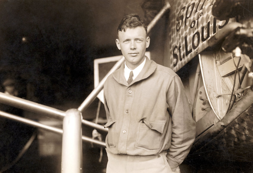Charles Lindbergh (1902-1974) posing by the plane in which he completed the first nonstop solo flight across the Atlantic, the Spirit of St. Louis.
