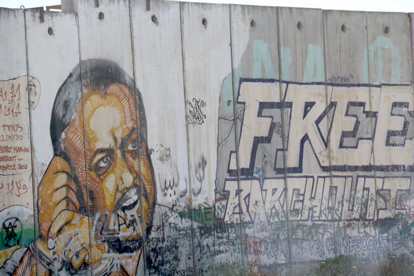 An image of Marwan Barghouti, the Fatah figure serving several life terms in an Israeli prison for murdering civilians, on a separation barrier near Qalandiya in 2016.