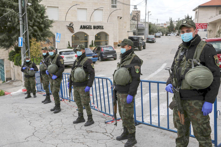 Palestinian security forces block the entrance to the Angel Hotel in Bethlehem on March 19.