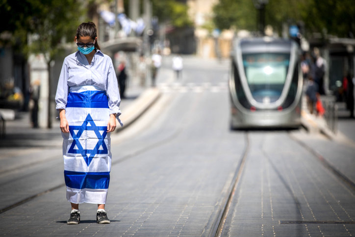 People stood still in Jerusalem as a two-minute siren sounded across Israel to mark Memorial Day on Tuesday. Mourning turned to joy as Israel celebrated its 72nd Independence Day starting Tuesday night.