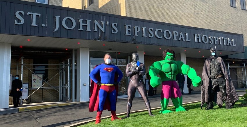 Superheros greet the coronavirus heros outside St. John's Episcopal Hospital in Far Rockaway.