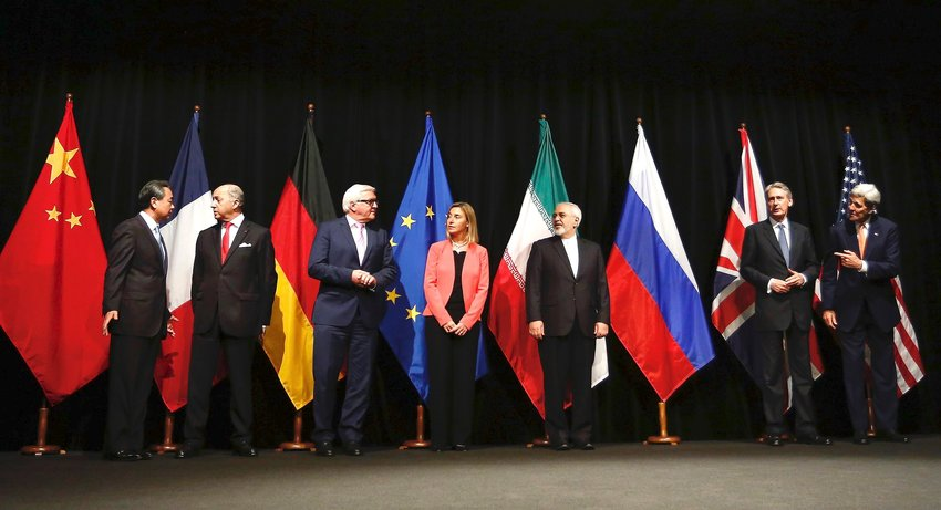 U.S. Secretary of State John Kerry (far right) poses with his P5+1 and Iranian negotiating partners in Vienna, Austria, shortly after the formal announcement of a nuclear deal between Iran and world powers.