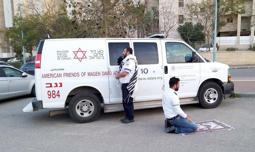 An Magen David Adom team -- a Jew and a Muslim -- each pray in their own way.