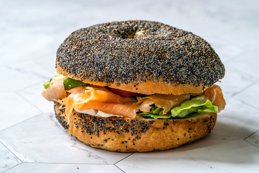 Poppyseed bagel with lox and cream cheese.