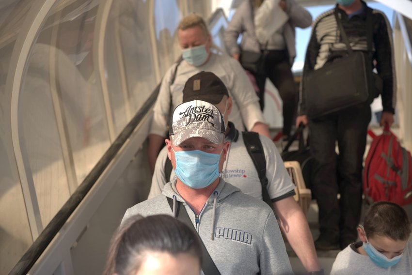 A group of new Jewish immigrants meant to arrive in Israel in March instead entered Ben-Gurion International Airport on May 20, 2020, due to delays as a result of the coronavirus.
