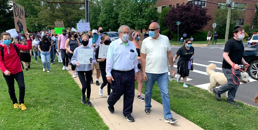 Rabbi Hershel Billet of the Young Israel of Woodmere joins Sunday's march as it began its 2-1/3 mile trek outside Andrew Parise Park in Cedarhurst.