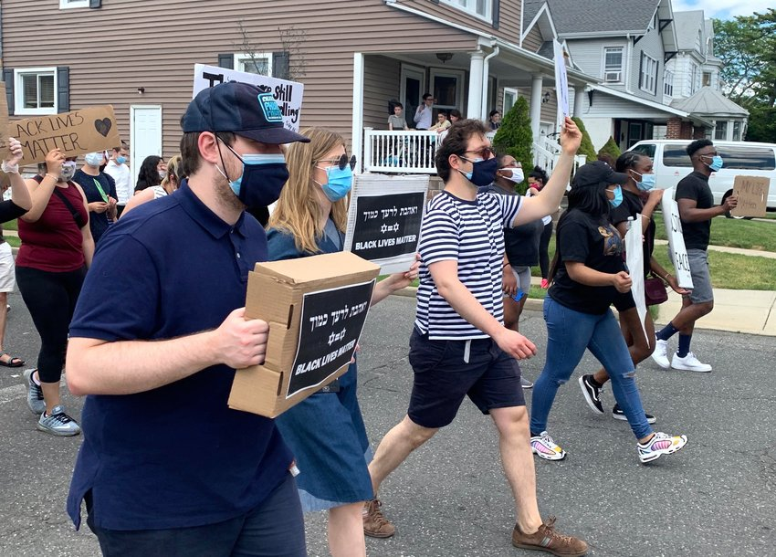 Some of the hundreds of protesters who marched through Cedarhurst and Lawrence on Sunday, on Cedarhurst Avenue at Monroe Street enroute to Andrew Parise (Cedarhurst) Park.