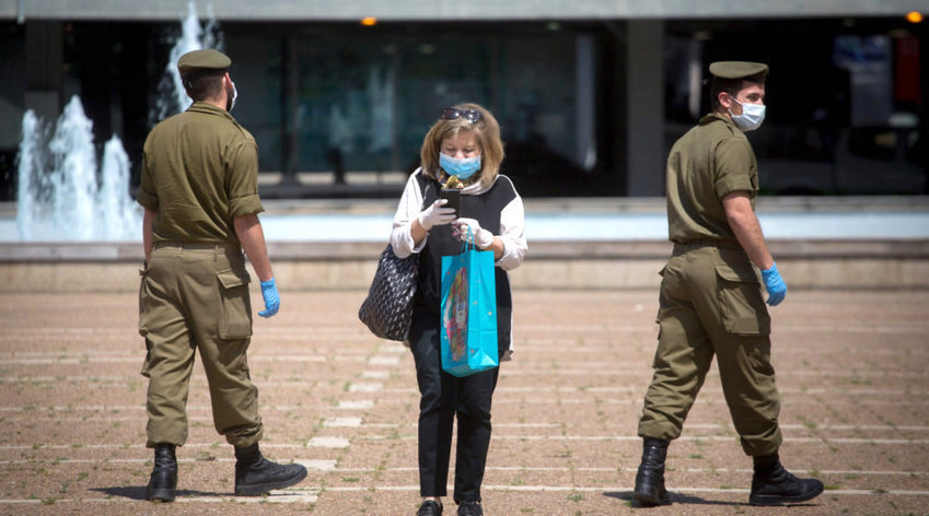 Israeli soldiers, pictured in Rabin Square on April 7, ensured compliance with the country's early COVID-19 lockdown. Israel enforced a moral decision to put life first, then made a political decision to reopen its economy.