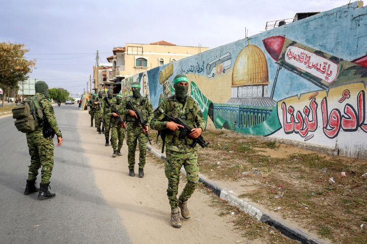 Members of Izz ad-Din al-Qassam Brigades, the armed wing of Hamas, during a patrol in Rafah in the southern Gaza Strip on April 27.
